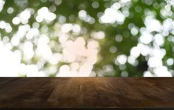 Empty dark wooden table in front of abstract blurred bokeh background of restaurant . can be used for display or montage your royalty free stock image