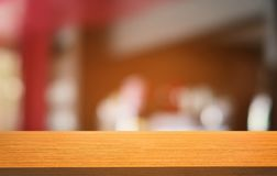 Empty dark wooden table in front of abstract blurred bokeh background of restaurant . can be used for display or montage your royalty free stock images