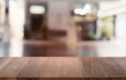 Empty dark wooden table in front of abstract blurred bokeh background of restaurant . can be used for display or montage your royalty free stock photography