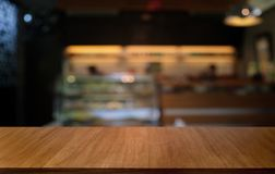 Empty dark wooden table in front of abstract blurred bokeh background of restaurant . can be used for display or montage your stock photography