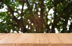 Empty dark wooden table in front of abstract blurred bokeh background of restaurant . can be used for display or montage your stock photos
