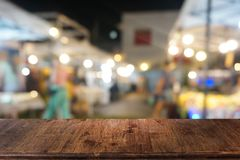 Empty dark wooden table in front of abstract blurred bokeh background of restaurant royalty free stock photos