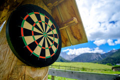 Empty dartboard outdoor wooden stand Stock Images