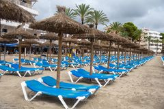 Crowded Beach at mallorca. Empty day Beds at paguera Beach stock images