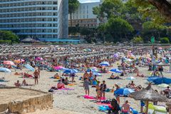 Crowded Beach at mallorca. Empty day Beds at paguera Beach stock photography