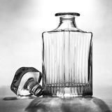 Empty decanter. On gray ground Stock Images