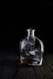 Empty decanter with smoke on black background Stock Image