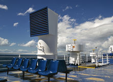 Empty deck. Bright blue empty sun deck of a ferry on a sunny day with a clear sky Royalty Free Stock Image
