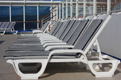 Empty deck chairs on the cruise ship. Empty lounge chairs on the sunny day on the cruise ship Stock Image