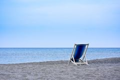 Empty deck chairs facing the sea Royalty Free Stock Photography