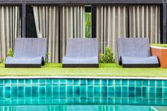 Empty deck chairs. With swimming pool Stock Photo