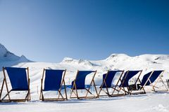 Empty deckchairs in alps Royalty Free Stock Photography