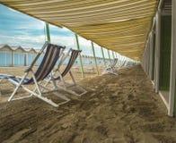 Empty deckchairs on beach Royalty Free Stock Photo