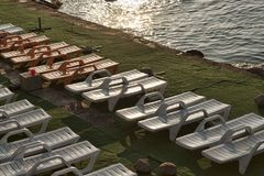 Empty deckchairs on a green carpet. Laid on reinforced concrete slabs. Alupka, Crimea, Ukraine royalty free stock images