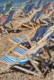 Empty deckchairs on a pebble beach Stock Image