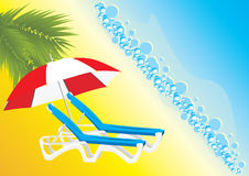 Empty deckchairs under an umbrella Royalty Free Stock Photo