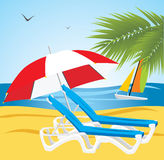 Empty deckchairs under an umbrella. Beach Stock Images
