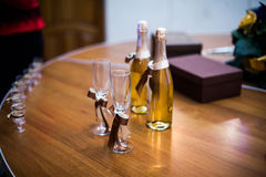 Empty decorated wineglasses and glasses of champagne and bottles Stock Images