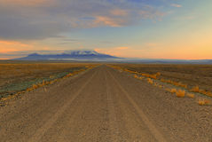 Empty desert dirt road Stock Images