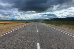 An empty desert road Stock Image