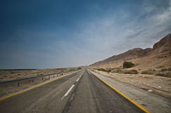 Empty desert road Stock Photography