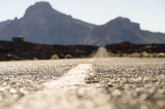 Empty desert road with mountains on background Stock Images