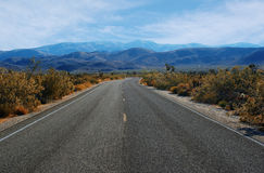 Empty desert winding road Royalty Free Stock Photo