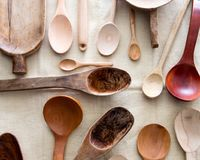 Empty design and ethnic carved wooden spoons mixed on linen Stock Image