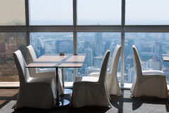 Empty Desk In A Skyscraper Restaurant Stock Image