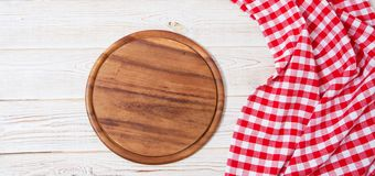 Empty desk,tablecloth on wooden table top view,copy space,food and drink concept.  royalty free stock photography