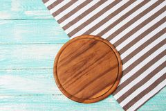 Empty desk,tablecloth on wooden table top view,copy space,food and drink concept.  royalty free stock image