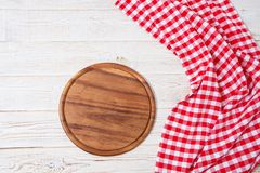 Empty desk,tablecloth on wooden table top view,copy space,food and drink concept.  royalty free stock photo