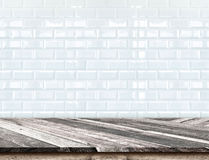 Free Empty Diagonal Wooden Table Top At Blurred White Tiles Ceramic W Stock Photos - 62190553