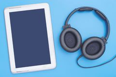 Empty digital tablet with headphone for Music and Movie mock up. Application Royalty Free Stock Photo