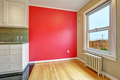 Empty dining area with bright red wall and window Stock Photos