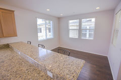 Empty dining room and kitchen bar with granite counter tops Stock Photos