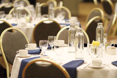 Empty dining seating. Empty banquet chairs and tables at a hotel Royalty Free Stock Photography