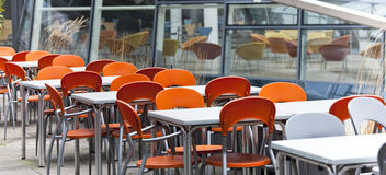 Empty dining tables and  chairs in a street cafe Royalty Free Stock Photo