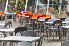 Empty dining tables and  chairs in a street cafe Stock Photography