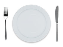 Empty dinner plate. With knife and fork on white Royalty Free Stock Photo