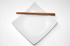 Empty dinner plate. Study of form and color, empty chinese dinner plate over white Stock Images