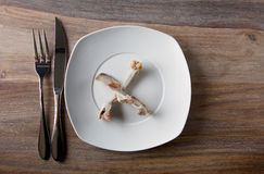Empty dinner plate with bones Stock Images