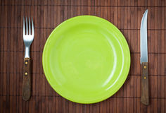 Empty dinner plate, knife and fork. Stock Images