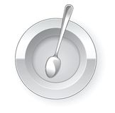 Empty dinner plate and spoon Stock Photo