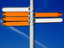 Empty directional signs. To the left and to the right and blue sky Royalty Free Stock Images