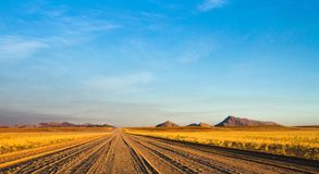 Empty dirt road across the the Namibian Desert stock photo
