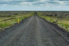 Empty dirt road from lava stones in perspective with green moss Stock Image