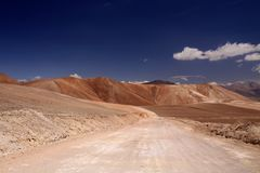 Empty dirt road to colorful Copiapo mountains in Atacama desert, Chile royalty free stock photos