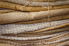 Empty dirty jute sacks. Stacked Royalty Free Stock Photos