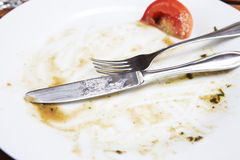 Empty dirty plate Stock Images